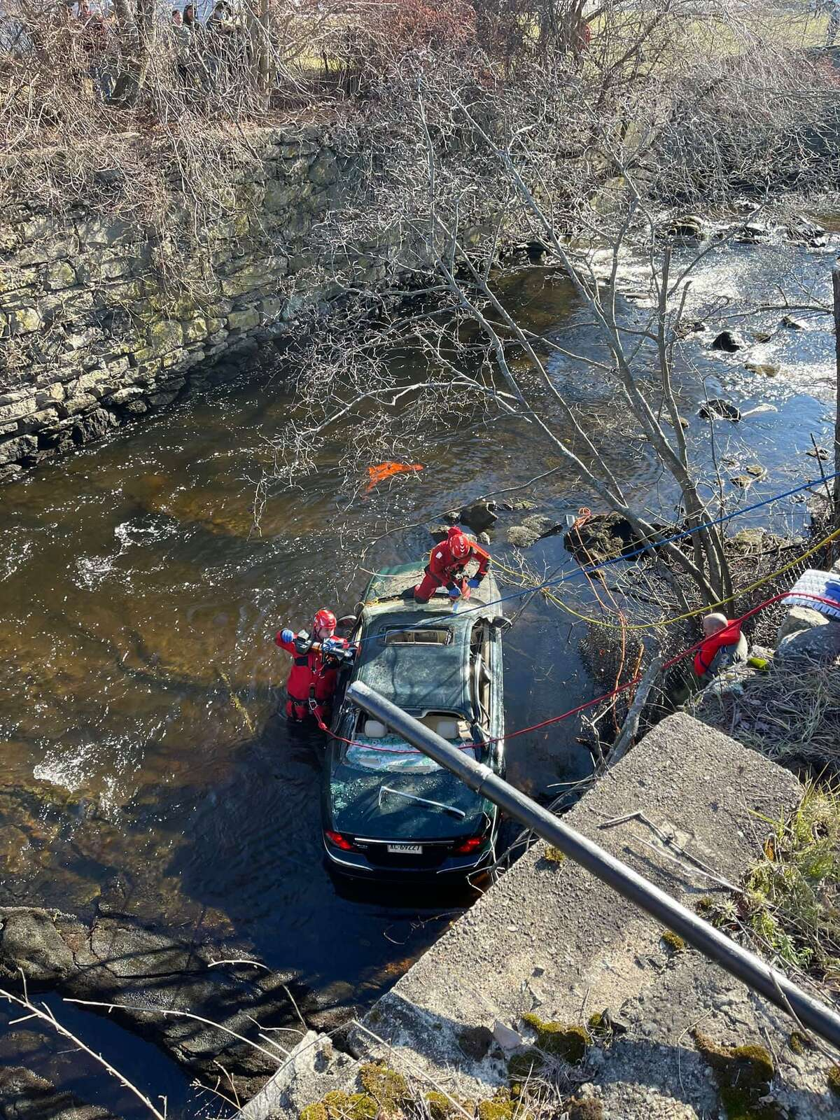 Emergency crews had to extricate a Plainfield driver from his vehicle after he crashed into the Five Mile River on Saturday.