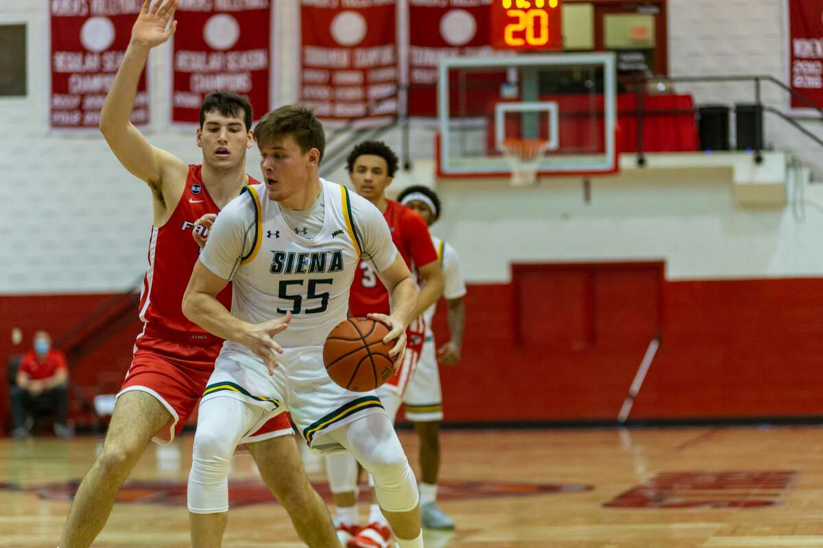 Siena's Jackson Stormo looks for room during a Metro Atlantic Athletic Conference basketball game Sunday, Jan. 10, 2021 at Alumni Hall in Fairfield, Conn. (Peter McLean/Fairfield athletics)