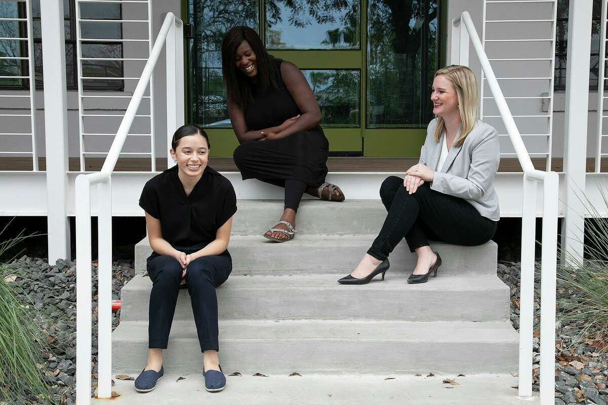 Suyapa Muñoz, from left, and Latonya Richard sit with Katie Vela, executive director of South Alamo Regional Alliance for the Homeless (SARAH), as they chat outside KGBTexas Communications in San Antonio on November 27, 2020. Muñoz and Richard are on SARAH's Youth Action Board.