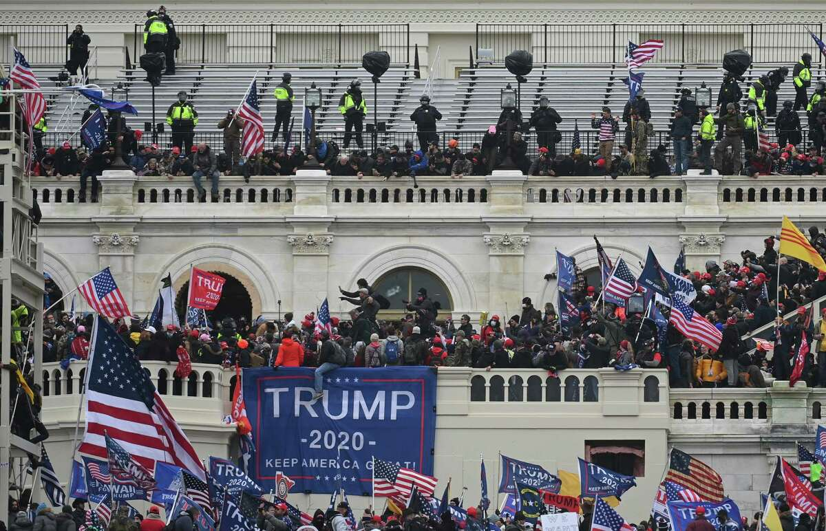 Supporters of President Donald Trump take over balconies and inauguration scaffolding at the Capitol on Wednesday, Jan. 6, 2021.