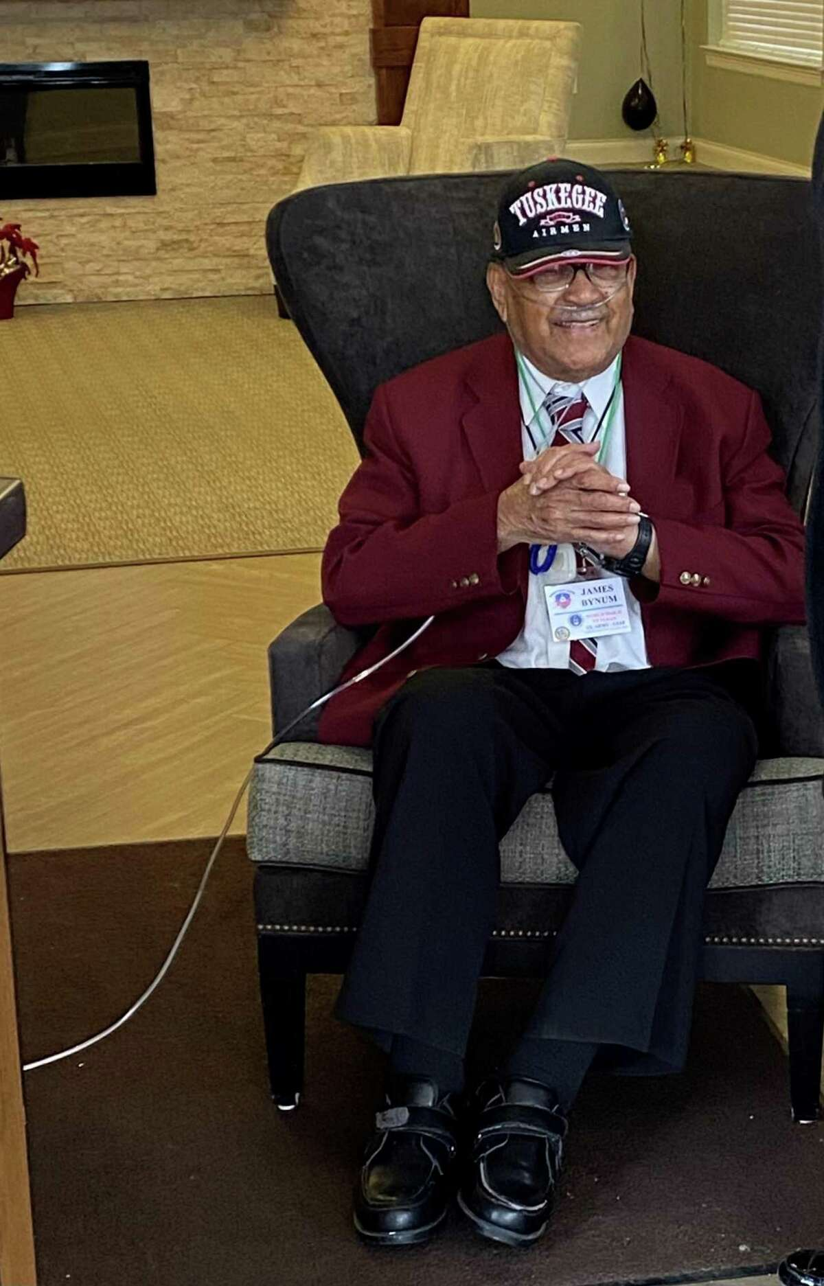 James Bynum, one of the last Tuskegee Airmen, is delighted Saturday as he's surprised by a parade celebrating his 100th birthday.
