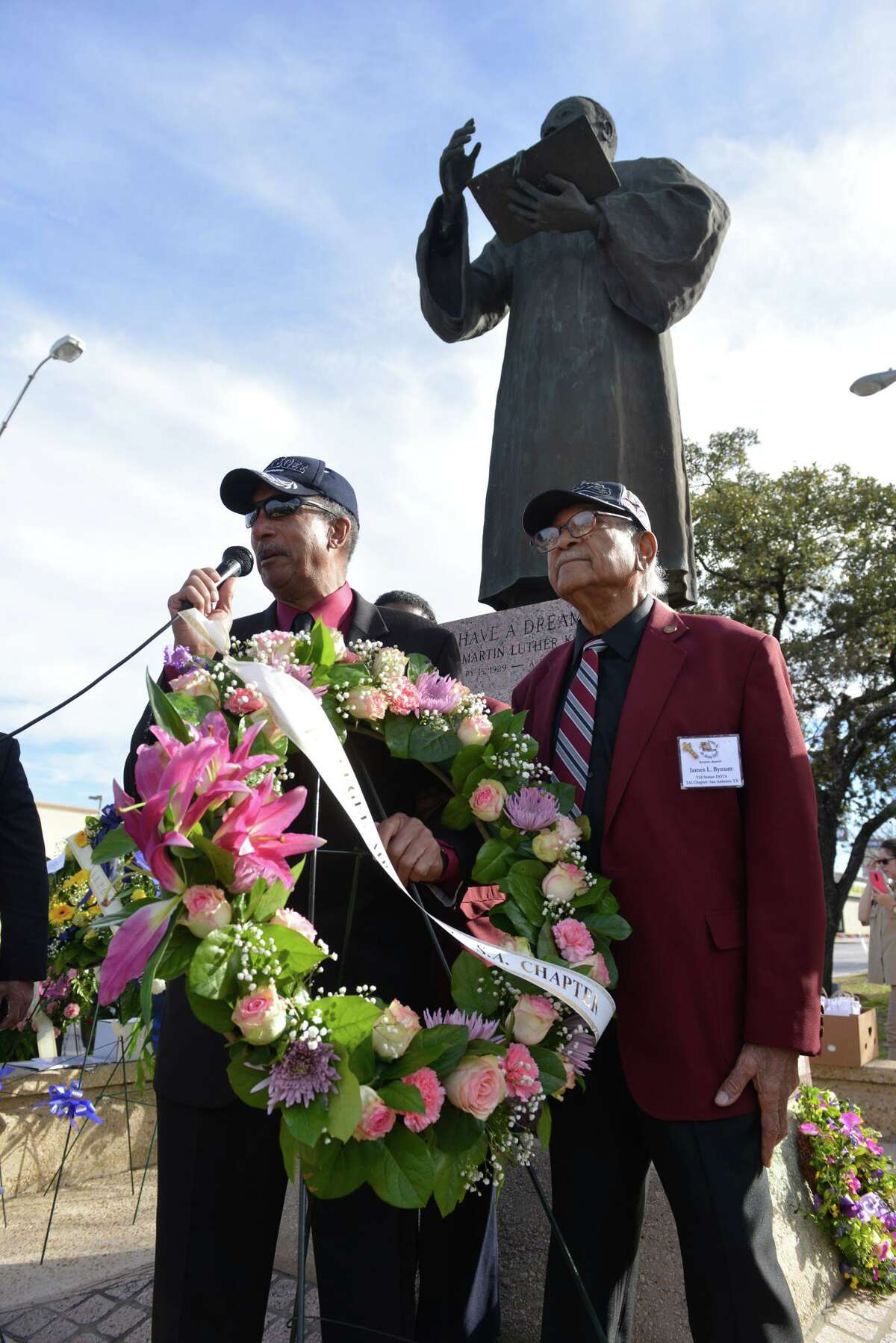 Rick Sinkfield and James Bynum present the Tuskeegee Airmen wreath during the Martin Luther King Jr. wreath laying ceremony Sunday afternoon. Hundreds attended the event at the corner of E. Houston St. and New Braunfels Ave.