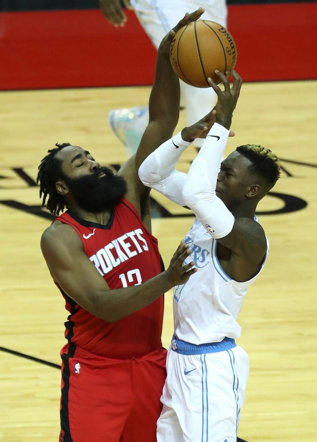 Houston Rockets guard James Harden (13) blocks a shot by Los Angeles Lakers guard Dennis Schroder (17) during the second quarter of an NBA basketball game on Sunday, Jan. 10, 2021, at Toyota Center in Houston.