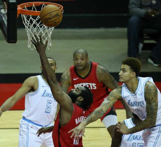 Houston Rockets guard James Harden (13) drives to the basket past Los Angeles Lakers forward Kyle Kuzma (0) during the third quarter of an NBA basketball game on Sunday, Jan. 10, 2021, at Toyota Center in Houston. Photo: Brett Coomer/Staff Photographer / © 2021 Houston Chronicle