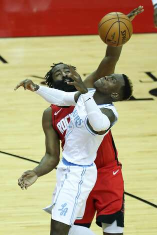 Houston Rockets guard James Harden (13) blocks a shot by Los Angeles Lakers guard Dennis Schroder (17) during the second quarter of an NBA basketball game on Sunday, Jan. 10, 2021, at Toyota Center in Houston. Photo: Brett Coomer/Staff Photographer / © 2021 Houston Chronicle
