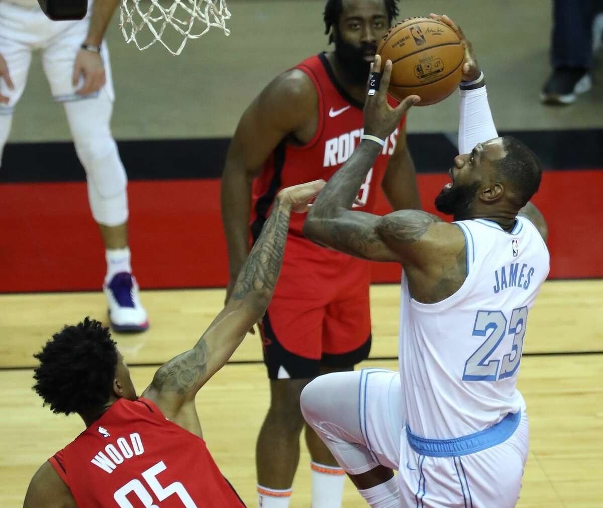 Los Angeles Lakers forward LeBron James (23) goes up for a shot against Houston Rockets center Christian Wood (35) during the second quarter of an NBA basketball game on Sunday, Jan. 10, 2021, at Toyota Center in Houston.