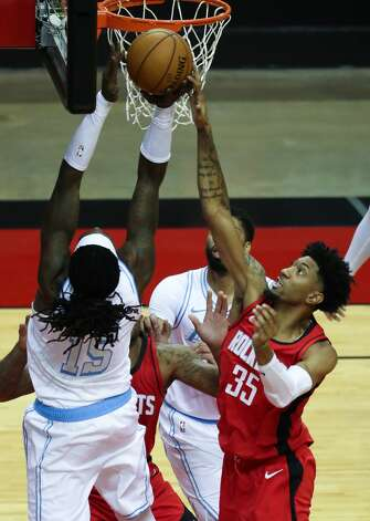 Houston Rockets center Christian Wood (35) blocks a shot by Los Angeles Lakers center Montrezl Harrell (15) during the second quarter of an NBA basketball game on Sunday, Jan. 10, 2021, at Toyota Center in Houston. Photo: Brett Coomer/Staff Photographer / © 2021 Houston Chronicle