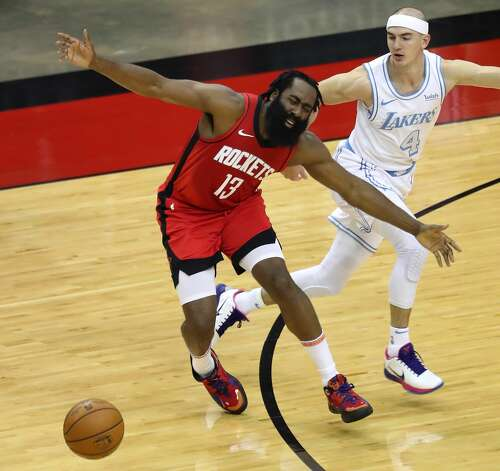 Houston Rockets guard James Harden (13) loses the handle on the ball as he goes up against Los Angeles Lakers guard Alex Caruso (4) during the first quarter of an NBA basketball game on Sunday, Jan. 10, 2021, at Toyota Center in Houston. Photo: Brett Coomer/Staff Photographer / © 2021 Houston Chronicle