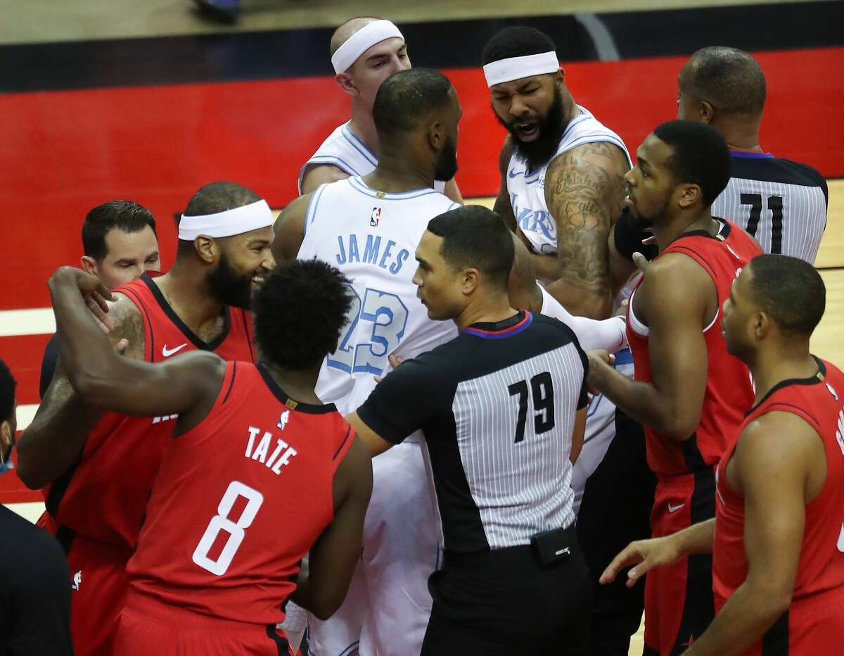 Los Angeles Lakers forward Markieff Morris, top right, gets into an altercation with Houston Rockets center DeMarcus Cousins, far left, during the first quarter of an NBA basketball game on Sunday, Jan. 10, 2021, at Toyota Center in Houston. Morris was ejected from the game after the incident.,