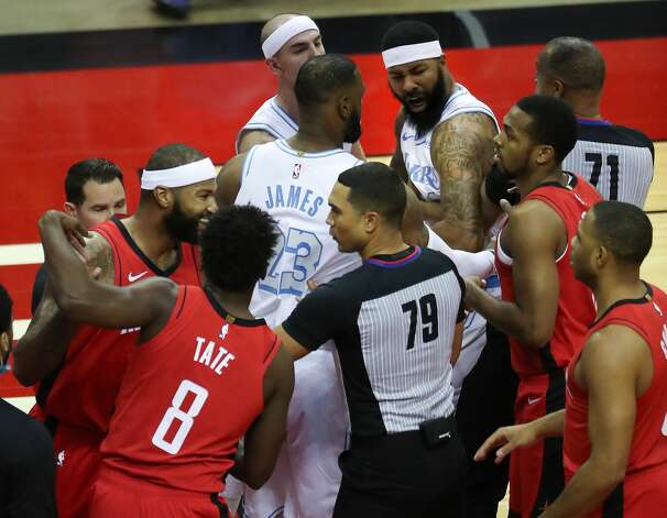 Los Angeles Lakers forward Markieff Morris, top right, gets into an altercation with Houston Rockets center DeMarcus Cousins, far left, during the first quarter of an NBA basketball game on Sunday, Jan. 10, 2021, at Toyota Center in Houston. Morris was ejected from the game after the incident., Photo: Brett Coomer/Staff Photographer / © 2021 Houston Chronicle