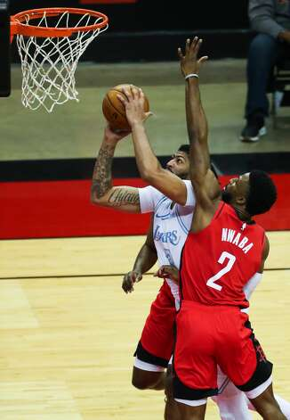Los Angeles Lakers forward Anthony Davis (3) takes the ball to the basket against Houston Rockets guard David Nwaba (2) during the first quarter of an NBA basketball game on Sunday, Jan. 10, 2021, at Toyota Center in Houston. Photo: Brett Coomer/Staff Photographer / © 2021 Houston Chronicle