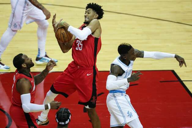 Houston Rockets center Christian Wood (35) pulls down a rebound against Los Angeles Lakers guard Dennis Schroder (17) during the first quarter of an NBA basketball game on Sunday, Jan. 10, 2021, at Toyota Center in Houston. Photo: Brett Coomer/Staff Photographer / © 2021 Houston Chronicle