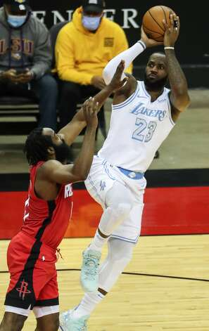 Los Angeles Lakers forward LeBron James (23) goes up for a shot over Houston Rockets guard James Harden (13) during the first quarter of an NBA basketball game on Sunday, Jan. 10, 2021, at Toyota Center in Houston. Photo: Brett Coomer/Staff Photographer / © 2021 Houston Chronicle