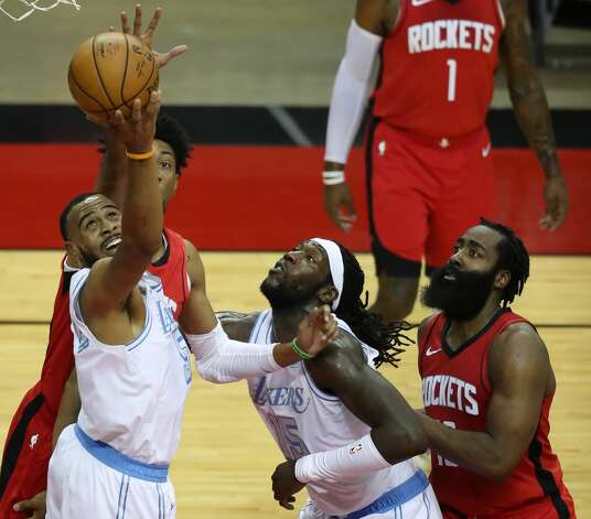 Los Angeles Lakers guard Talen Horton-Tucker (5) takes the ball to the basket past Houston Rockets guard James Harden (13) during the second quarter of an NBA basketball game on Sunday, Jan. 10, 2021, at Toyota Center in Houston. Photo: Brett Coomer/Staff Photographer / © 2021 Houston Chronicle