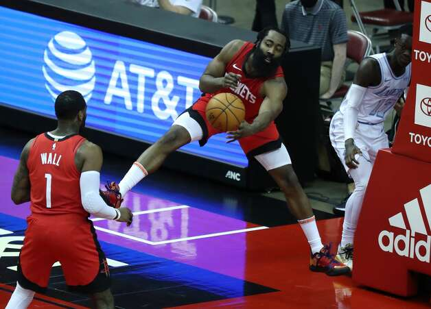 Houston Rockets guard James Harden (13) tosses the ball back to guard John Wall (1) as he tries to save a ball from going out of bounds against the Los Angeles Lakers during the fourth quarter of an NBA basketball game on Sunday, Jan. 10, 2021, at Toyota Center in Houston. The Lakers beat the Rockets 120-102. Photo: Brett Coomer/Staff Photographer / © 2021 Houston Chronicle