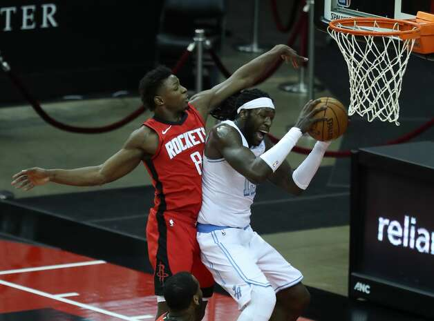 Houston Rockets forward Jae'Sean Tate (8) defends a drive to the basket by Los Angeles Lakers center Montrezl Harrell (15) during the fourth quarter of an NBA basketball game on Sunday, Jan. 10, 2021, at Toyota Center in Houston. The Lakers beat the Rockets 120-102. Photo: Brett Coomer/Staff Photographer / © 2021 Houston Chronicle