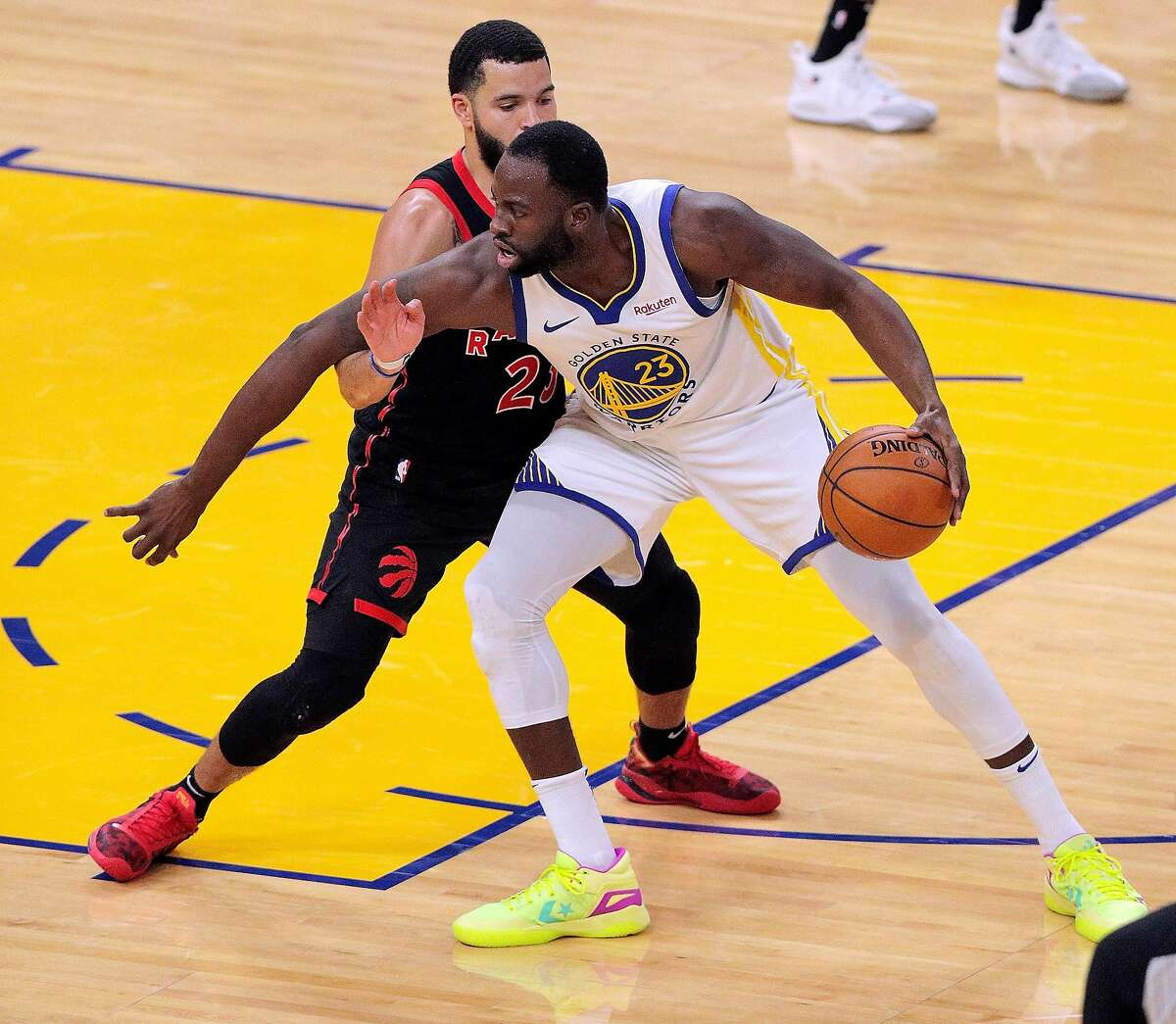Draymond Green (23) defended by Fred Van Vleet (23) in the first half as the Golden State Warriors played the Toronto Raptors at Chase Center in San Francisco, Calif., on Sunday, January 10, 2021.
