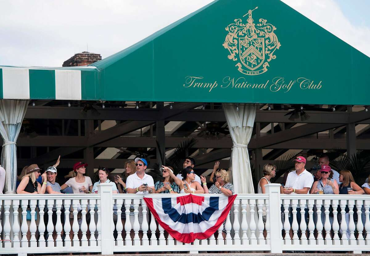 People watch President Trump arrive for the 2017 U.S. Women's Open Championship at his course in Bedminster, N.J.