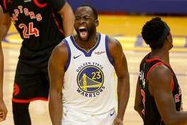 SAN FRANCISCO, CALIFORNIA - JANUARY 10: Draymond Green #23 of the Golden State Warriors reacts after he made a basket and was fouled during their game against the Toronto Raptors at Chase Center on January 10, 2021 in San Francisco, California. NOTE TO USER: User expressly acknowledges and agrees that, by downloading and or using this photograph, User is consenting to the terms and conditions of the Getty Images License Agreement. (Photo by Ezra Shaw/Getty Images)