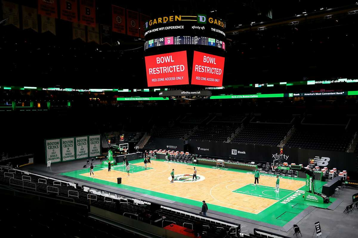 TD Garden in Boston was quiet after Sunday's scheduled Heat-Celtics game was canceled due to coronavirus issues.