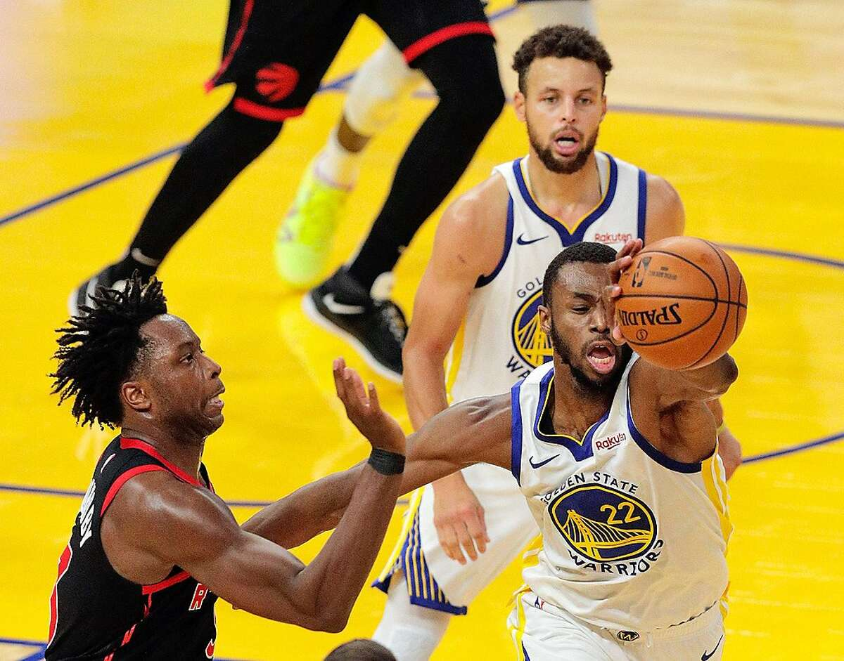 Andrew Wiggins (22) goes for a rebound late in the second half as the Golden State Warriors played the Toronto Raptors at Chase Center in San Francisco, Calif., on Sunday, January 10, 2021.