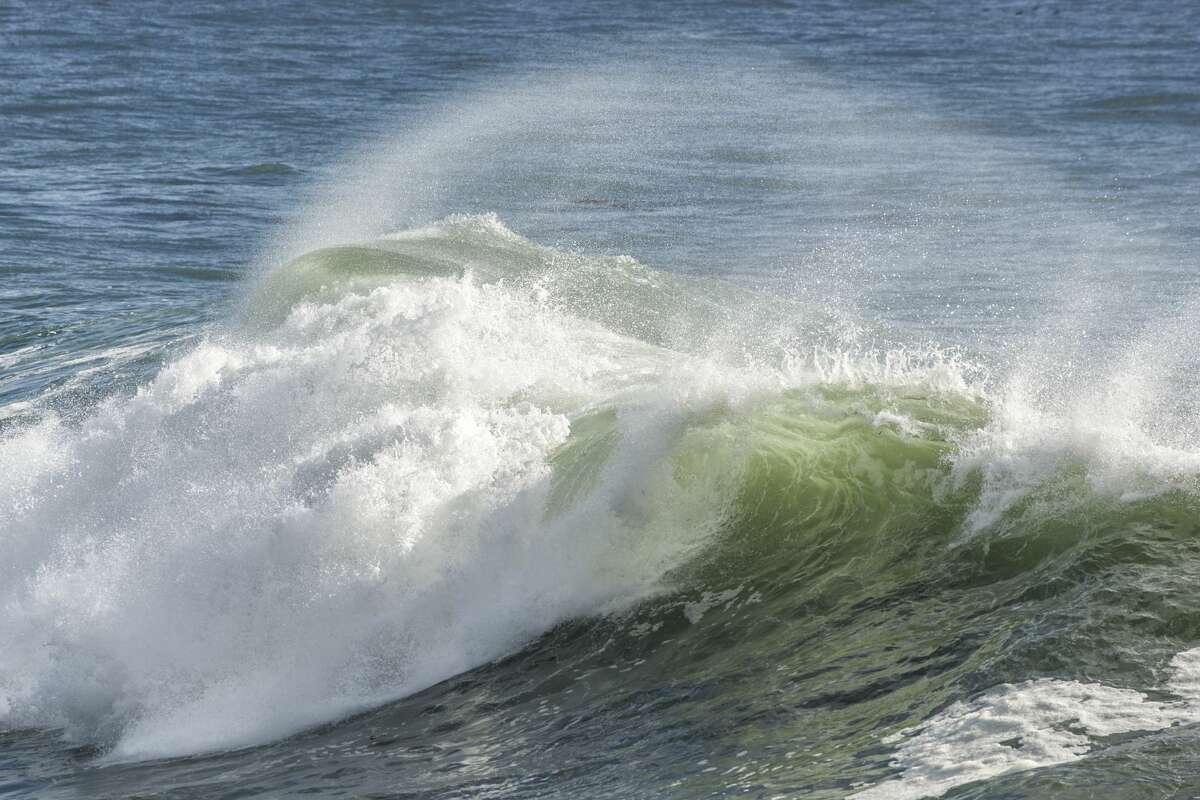 File -- Turbulent ocean waves after a violent pacific coast storm in Santa Cruz, Calif.