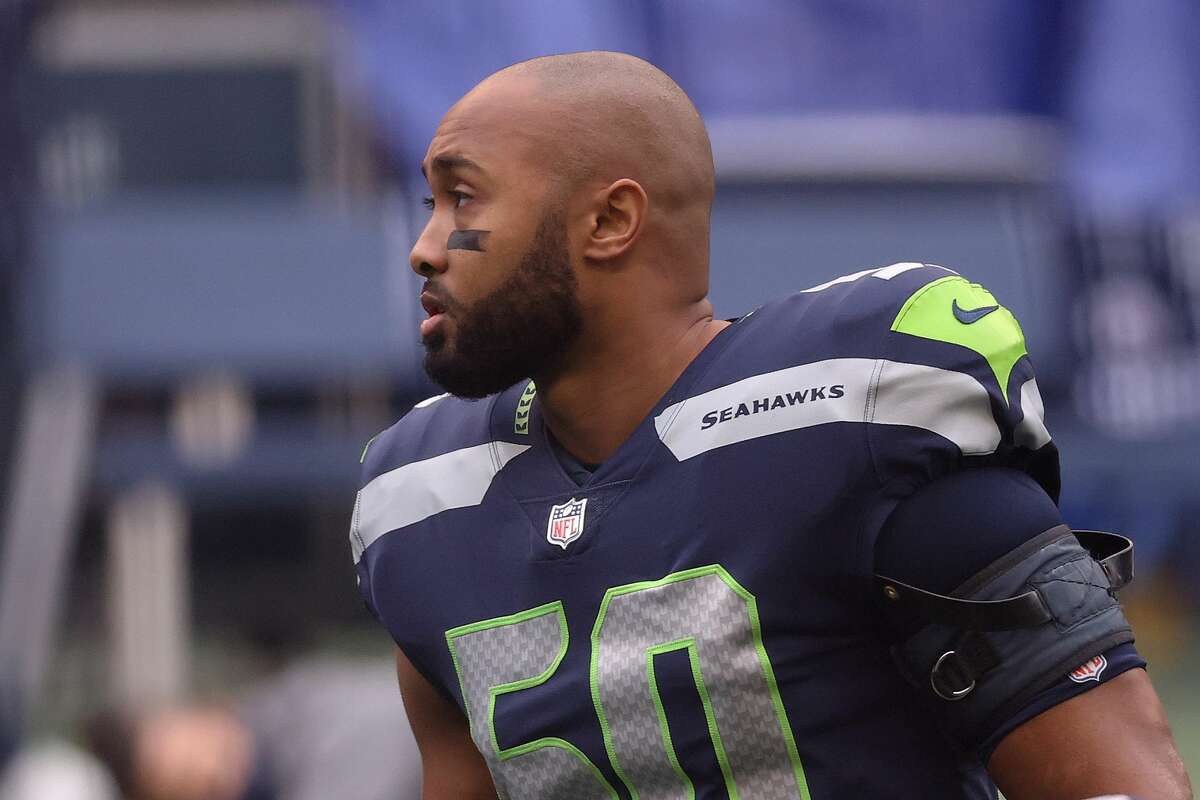 SEATTLE, WASHINGTON - DECEMBER 13: K.J. Wright #50 of the Seattle Seahawks looks on before their game against the New York Jets at CenturyLink Field on December 13, 2020 in Seattle, Washington. (Photo by Abbie Parr/Getty Images)
