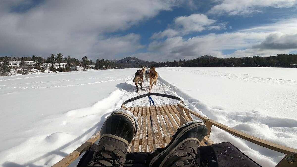 Dog sledding on the ice near the Mirror Lake Inn at Lake Placid.