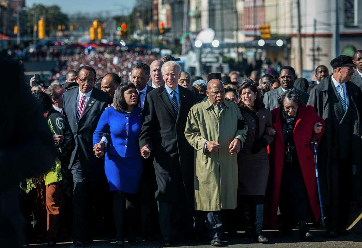 Joseph Biden walks with civil rights leaders and lawmakers over the historic Edmund Pettus Bridge in Selma, Ala., on March 3, 2013.