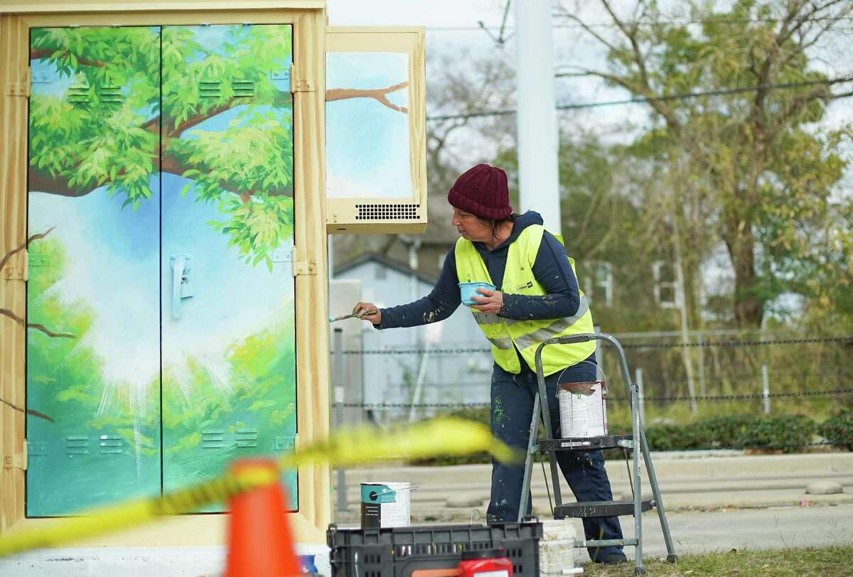 Houston-base artist Anat Ronen paints a mural to bring attention to human trafficking on a Metro cabinet near Moody Park in Houston on Friday, January 8, 2021.