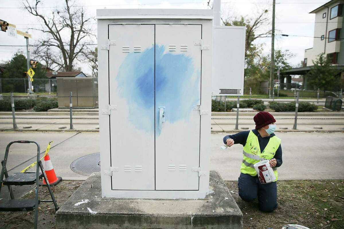 Houston-base artist Anat Ronen starts painting a mural to bring attention to human trafficking on a Metro cabinet near Moody Park in Houston on Friday, January 8, 2021.