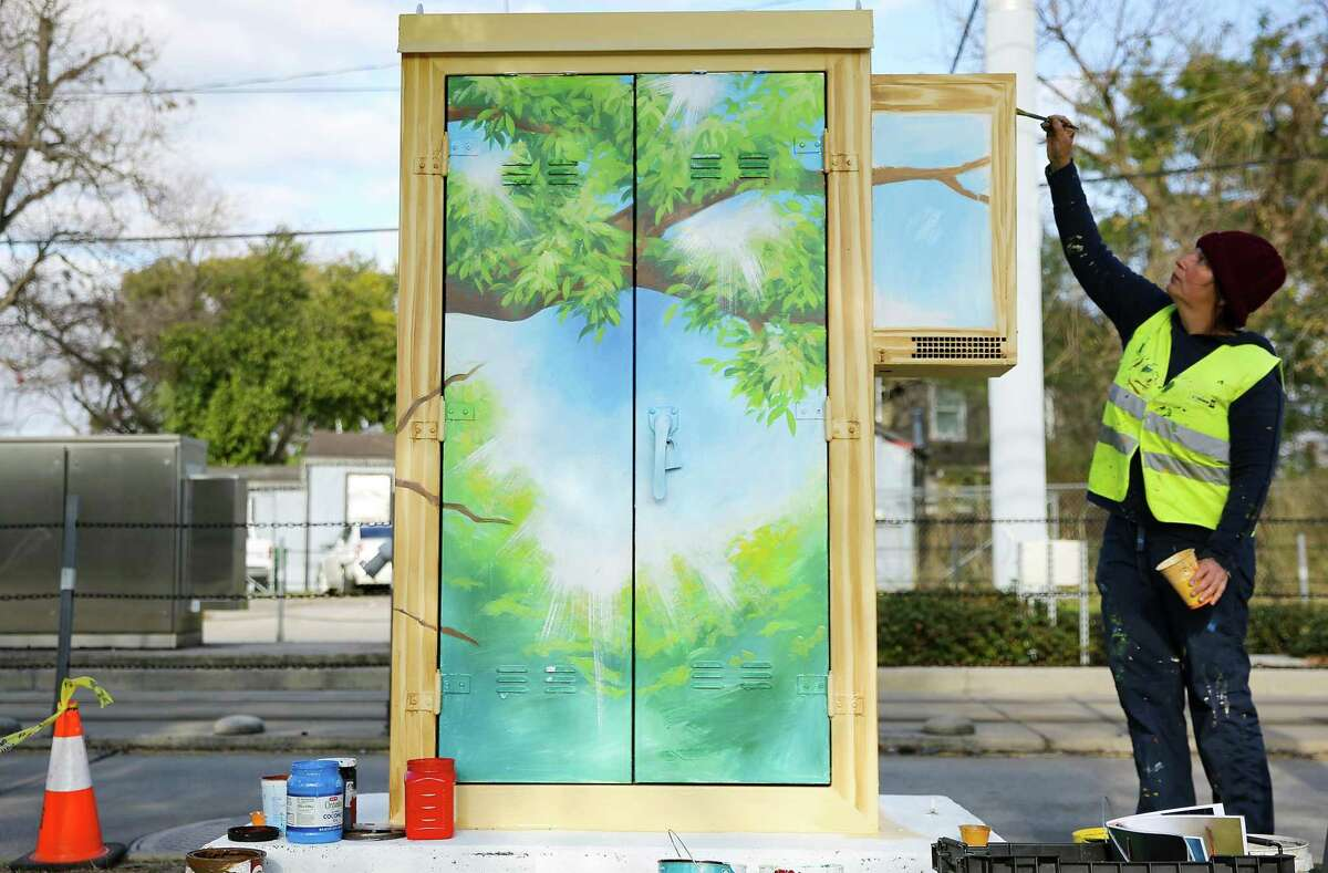 Houston-based artist Anat Ronen paints a mural to bring attention to human trafficking on a Metro cabinet near Moody Park in Houston on Friday, January 8, 2021.