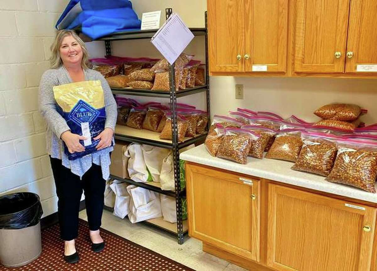 Sara Berkbigler, the director of Main Street Community Center, organizing food donations made by Partners for Pets to help the community's homebound seniors.