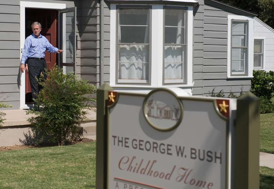 Former President George W. Bush exits his childhood home after a tour in Midland, Texas, on October 4, 2008. The National Park Service held a virtual public meeting Tuesday to discuss the process of designating the George W. Bush Childhood Home as a national park. Photo: SAUL LOEB/AFP Via Getty Images / 2008 AFP
