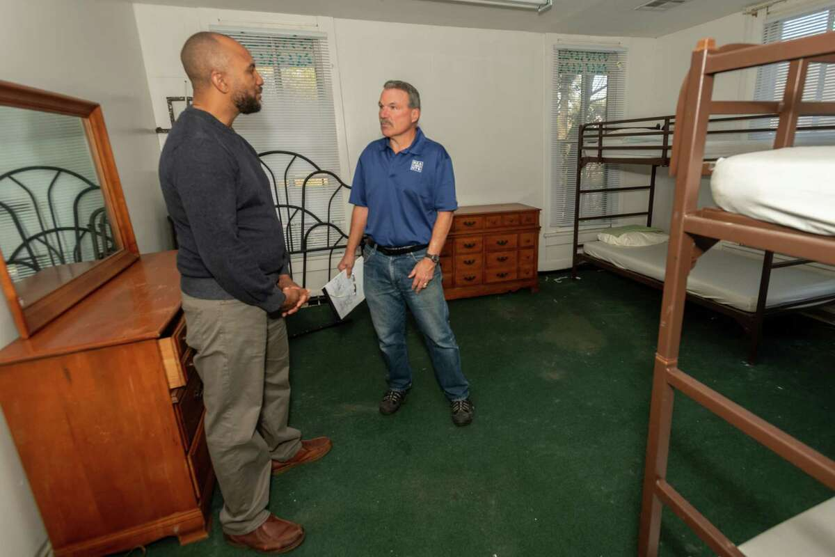 Captain Jason Moore of the Salvation Army and Beaumont City Councilman Mike Getz stand in one of the bedrooms of a building in the 1000 block of McFaddin Avenue which may be converted into a homeless shelter. Photo made Thursday, December 26, 2019. Fran Ruchalski/The Enterprise
