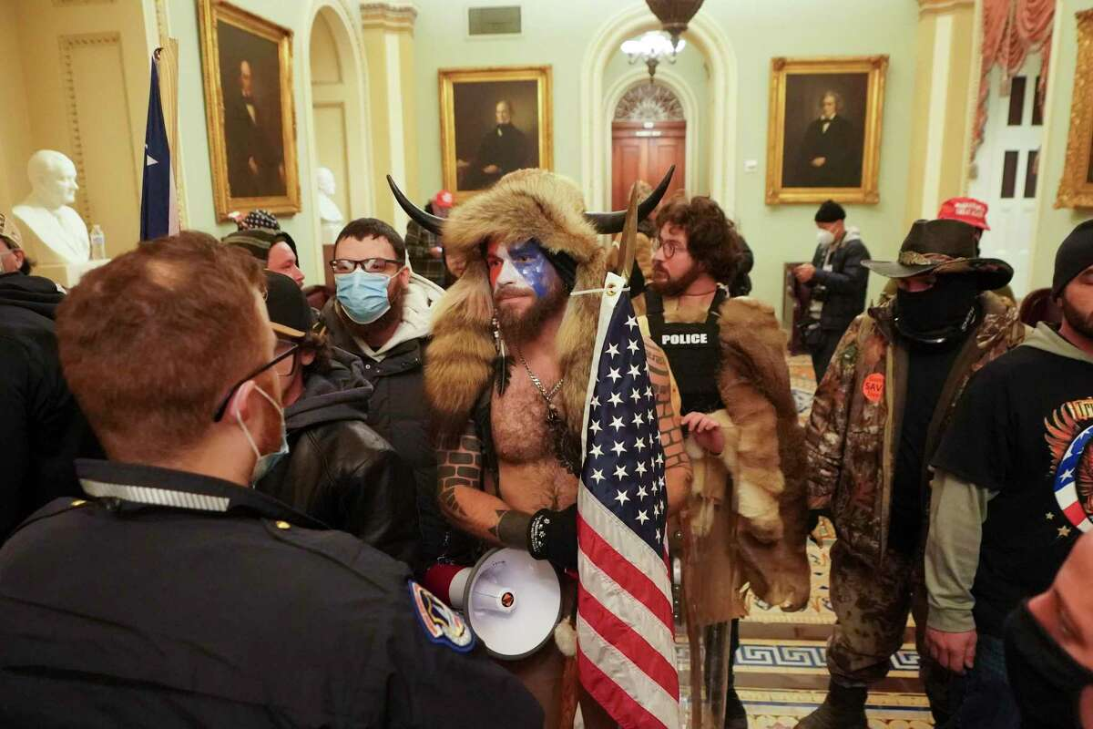 Supporters of President Donald Trump confront Capitol Police inside the Capitol Building in Washington, Jan. 6, 2021. The police force, which numbers about 2,000 officers and has sole jurisdiction over the Capitol?•s buildings and grounds, was clearly outnumbered and unprepared for the onslaught, even as it was openly organized on social media sites like Gab and Parler. (Erin Schaff/The New York Times)