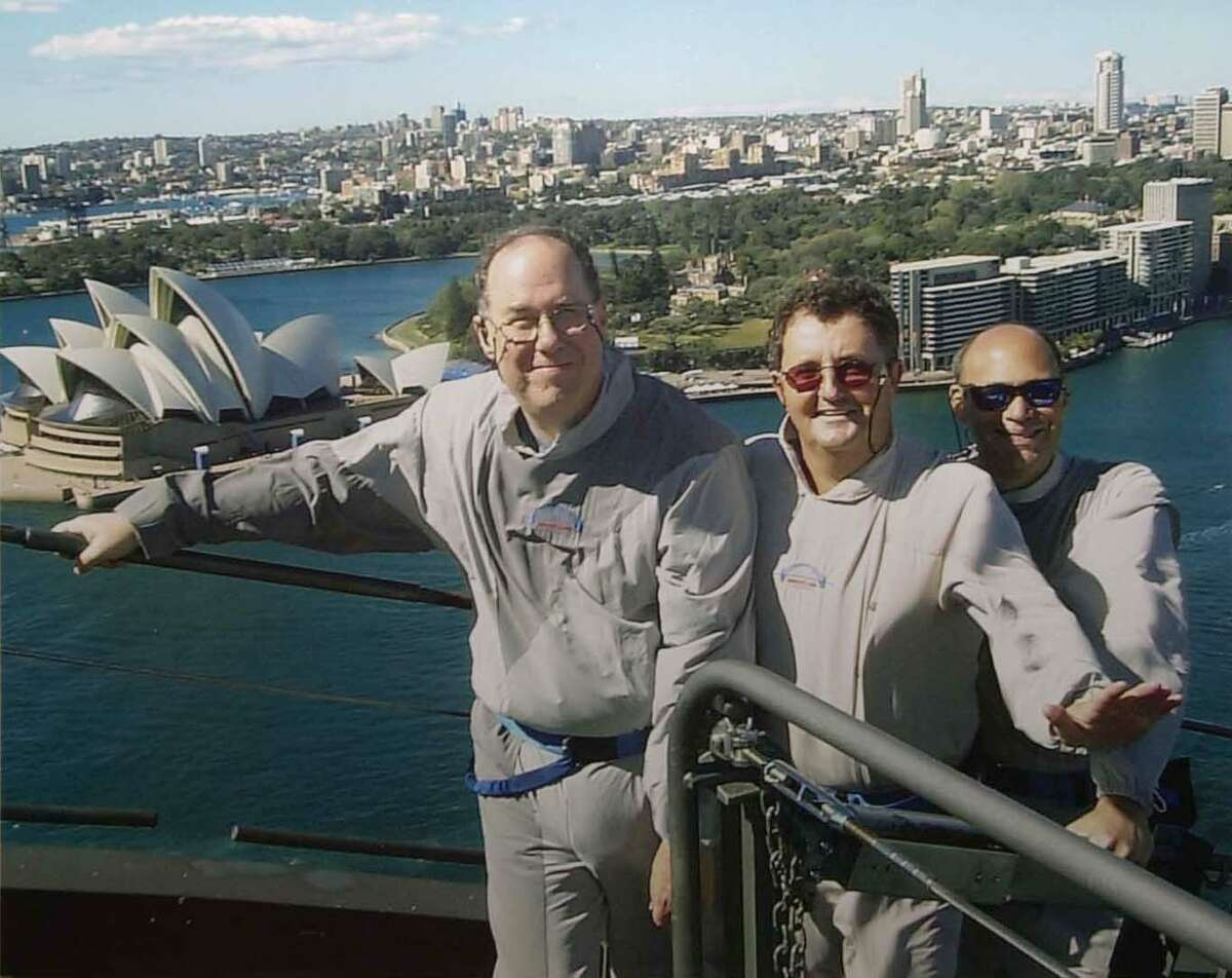 Houston Chronicle sports writers (from left) David Barron, Fran Blinebury and Danny Robbins stand at the top of the Sydney Harbour Bridge while in Australia to cover the 2000 Summer Olympics. Barron is retiring from the Chronicle this month after 31 years with the newspaper.