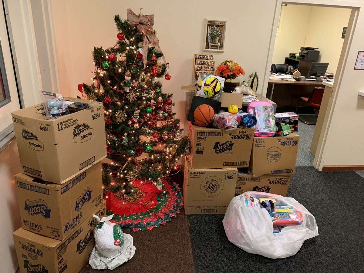 Torrington Lions Club recently donated holiday gifts to the Salvation Army and the Torrington Fire Department's annual Christmas for Children gift drive.