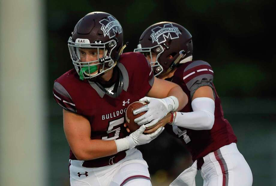 Magnolia running back Mitch Hall (5) was named the District 8-5A Co-Most Valuable Player after scoring 21 touchdowns this season. Photo: Jason Fochtman, Houston Chronicle / Staff Photographer / 2020 © Houston Chronicle