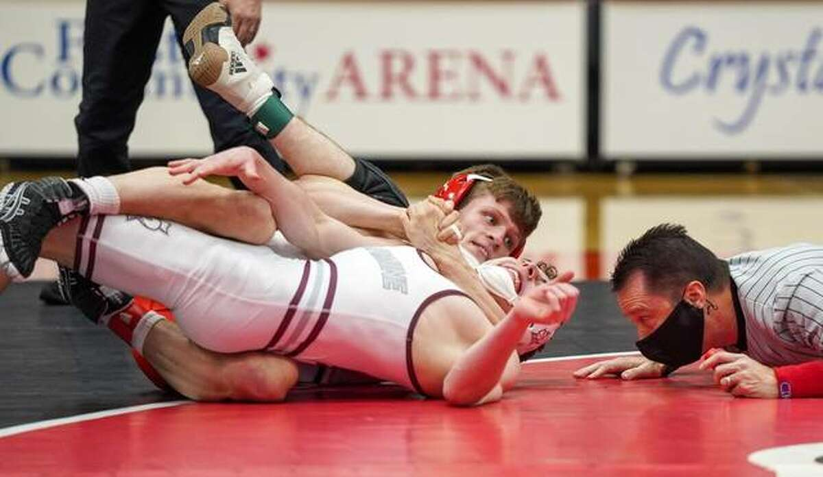 SIUE's Aaron Schulist pins his Bellarmine opponent during Sunday's meet to open the 2021 season inside First Community Arena in Edwardsville.