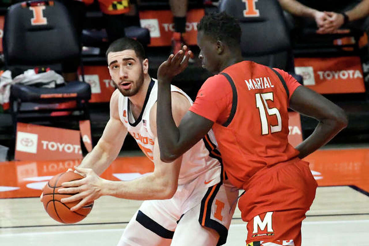 Illinois forward Giorgi Bezhanishvili (15) looks to pass as he is pressured by Maryland center Chol Marial (15) in the first half of an NCAA college basketball game, Sunday, Jan. 10, 2021, in Champaign, Ill.