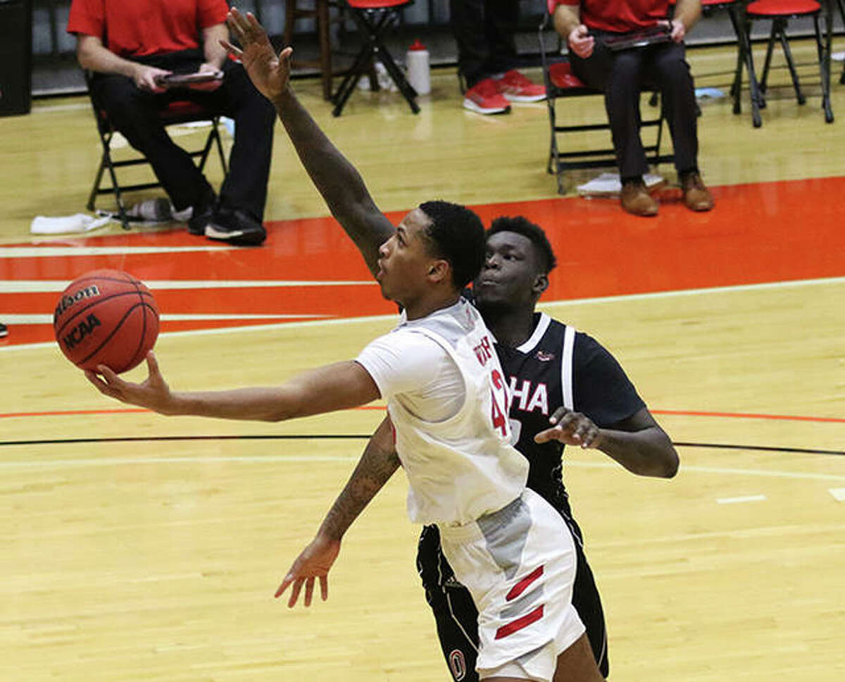 SIUE's Shamar Wright (front) gets to the basket against an Omaha defender during a Dec. 5 college men's basketball game at First Community Arena in Edwardsville. The 3-4 Cougars, who last played Dec. 18 because of COVID-19 protocols, return to the FCA on Tuesday against Eastern Illinois.