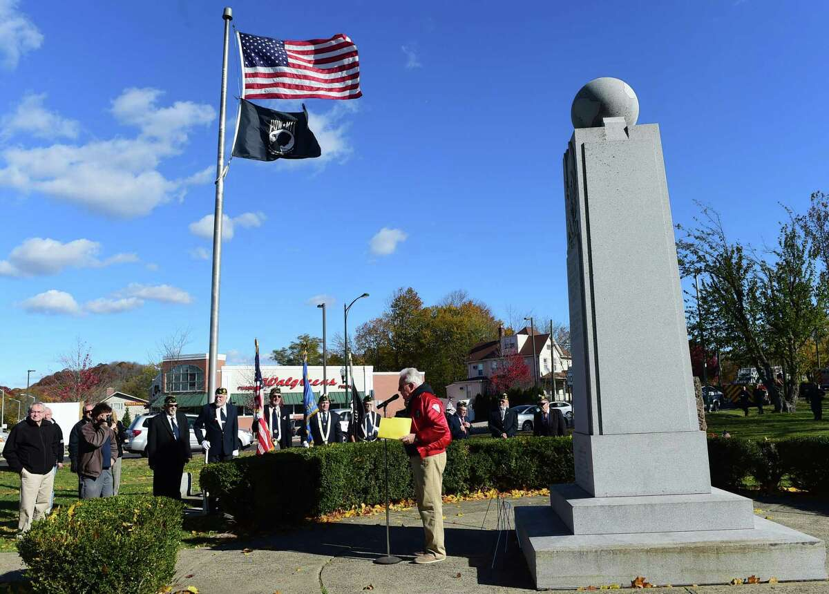 (Peter Hvizdak - New Haven Register) Jack Stacey of the East Haven Veterans Council speaks during the East Haven Veterans Day ceremony Friday, November 11, 2016 at the War Memorial on the East Haven Green.