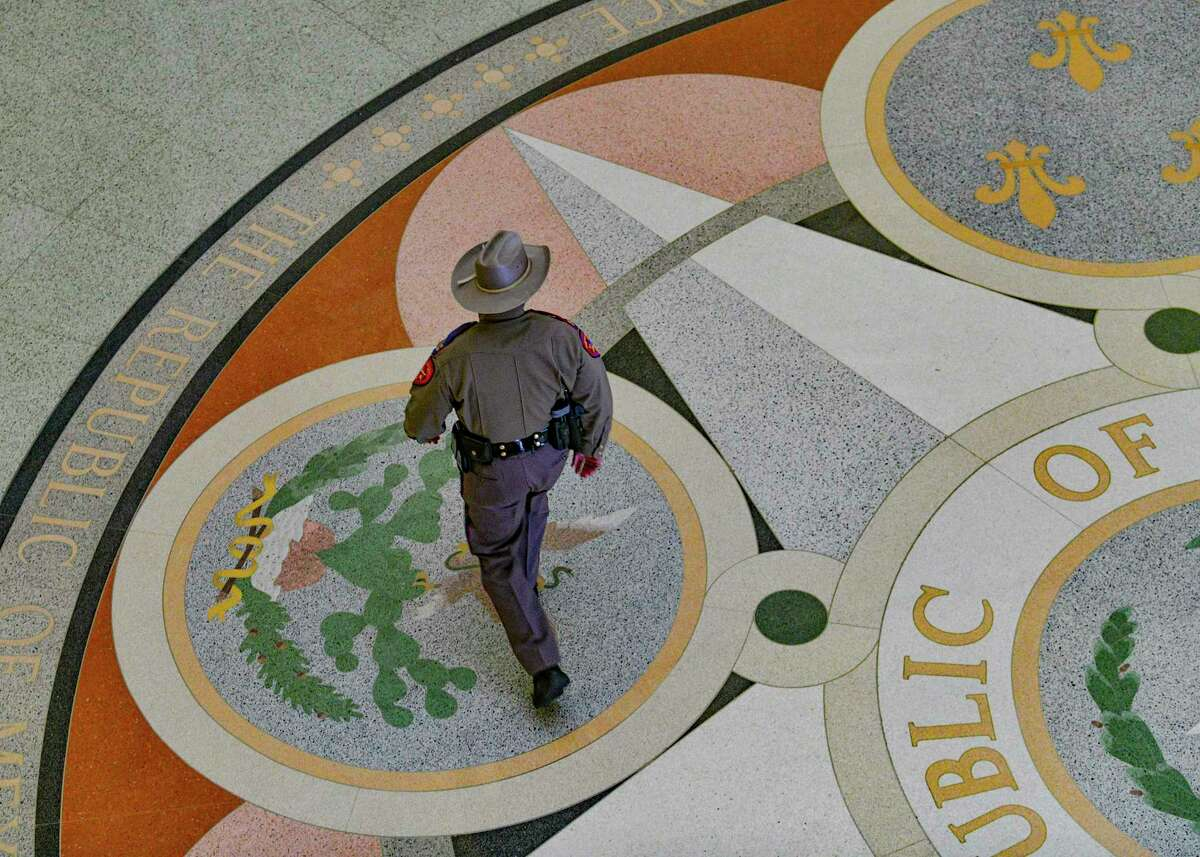 A Department of Public Safety trooper walks the floors of the Texas Capitol on Thursday, Jan. 7, 2020.