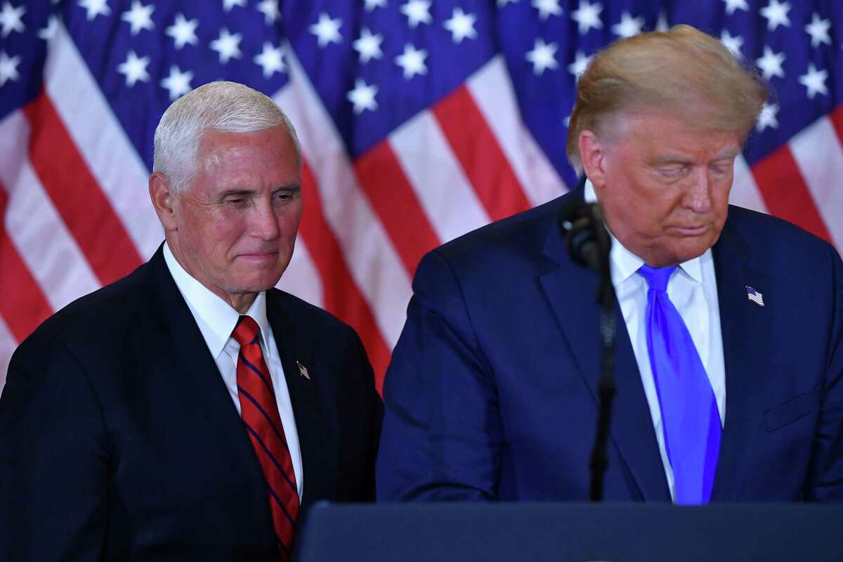 In this file photo, President Donald Trump and Vice President Mike Pence speak on Election Night 2020.