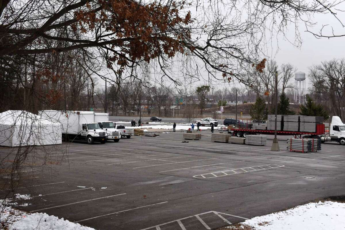 Workers erect a new walk-up vaccination site at the University at Albany in its Northwest Gold parking lot on Monday, Jan. 11, 2021, in Albany, N.Y. The site is said to be operational by Friday. (Will Waldron/Times Union)