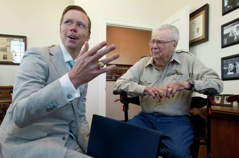 State Rep. Will Metcalf, picture here in a file photo with World War II veteran Merle Frederick Ward, is ready to get back to work as the 87th Legislative Session kicks off Tuesday but noted the upcoming months could be challenging. Photo: Jason Fochtman, Houston Chronicle / Staff Photographer / Houston Chronicle