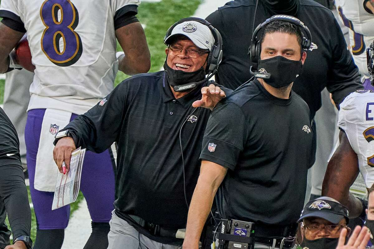 David Culley, center, has been with the Ravens the past two seasons as passing game coordinator and receivers coach.
