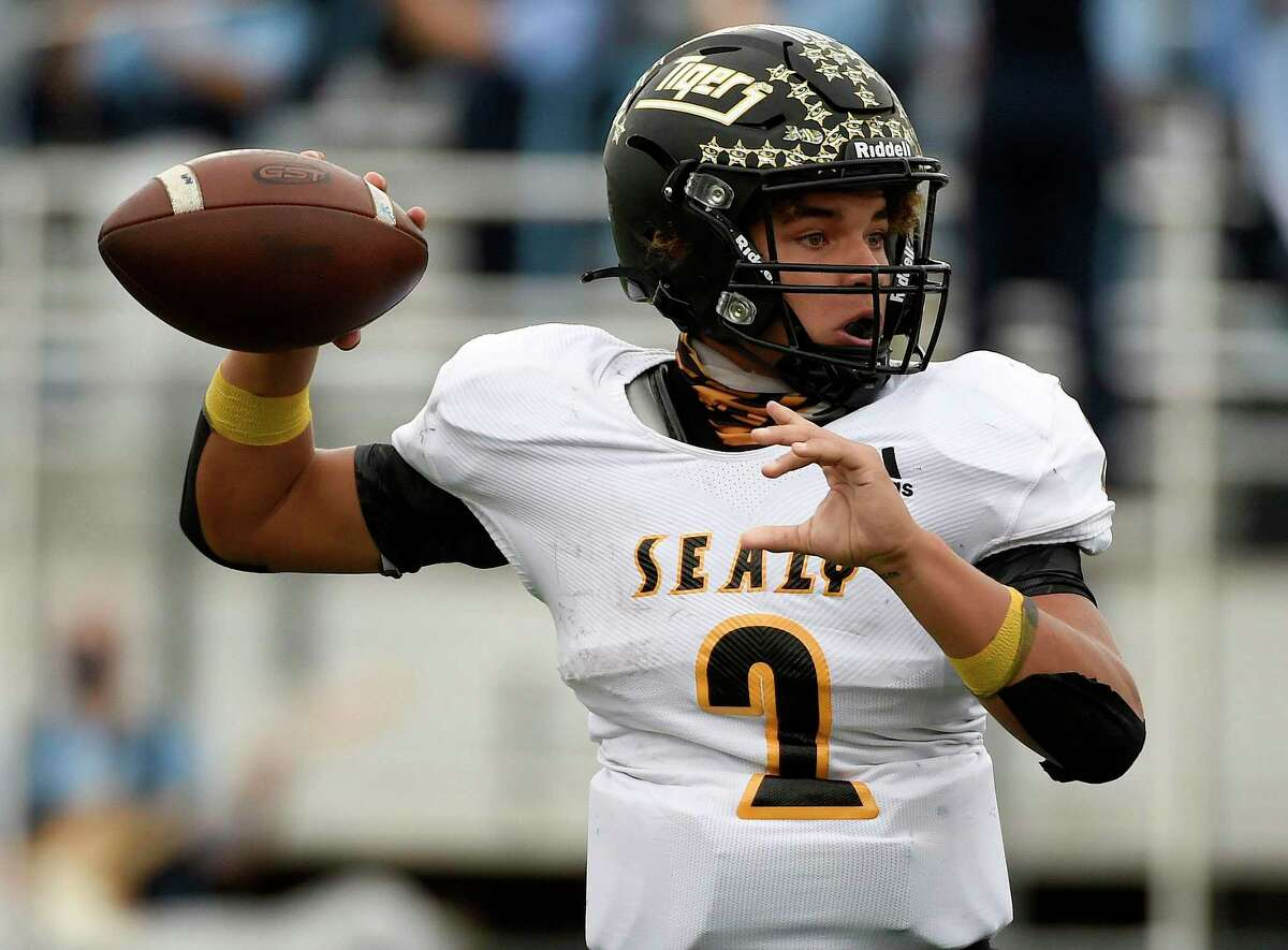 Sealy quarterback D'Vonne Hmielewski throws a pass during the first half of a 4A Division II Region III semifinal high school football game against China Spring, Friday, Nov. 27, 2020, in College Station, TX.