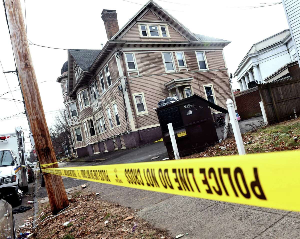 New Haven Police on the scene of a double homicide at the corner of Winthrop Avenue and Chapel Street in New Haven on January 11, 2021.